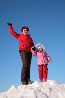 Free Mother And Child Stand On Top Of Snowy Hill Stock Photos - 4485453