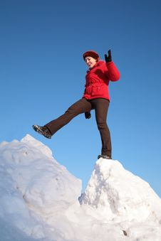 Woman Steps From One Snowy Chunk To Another Stock Photography