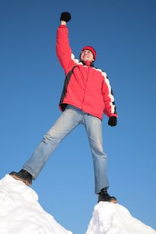 Free Man In Red Jacket On Top Of Snow Hill Royalty Free Stock Photography - 4485497