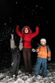 Free Children And Mother Throw Snow In Night 3 Stock Photos - 4485613