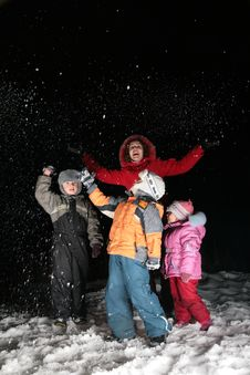 Children And Mother Throw Snow In Night Stock Image