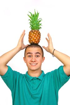 Boy With Pineapple Stock Photos