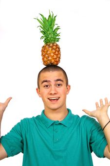 Boy With Pineapple Stock Images
