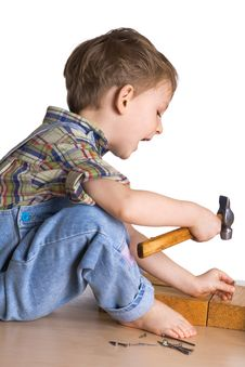 Free Kid Hammers A Hammer In Nails Royalty Free Stock Photos - 4489098