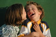 Girl Teasing Boy Stock Image
