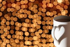 Free Cup On Bokeh Lights Stock Image - 4489901