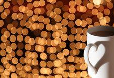 Cup On Bokeh Lights Stock Image