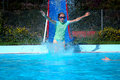 Free Girl Going Down Slide Into Swimming Pool Royalty Free Stock Photography - 4490027