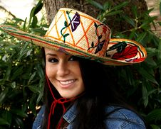 Girl Modeling Colorful Sombrero Stock Image