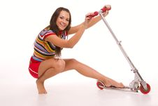 Free Pretty Young Woman With Scooter Stock Photography - 4494632