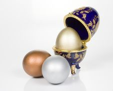 Gold Egg In Eggcup Stock Images