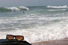 Free Sunglasses On A Rock Near Waves Royalty Free Stock Photo - 458375