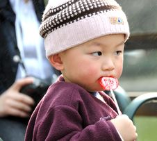 Free Lovely Baby And Colourful Lollipop Stock Photos - 4500733