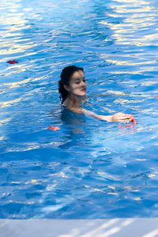 Free Young Girl In Swiming Pool Royalty Free Stock Photography - 4502237