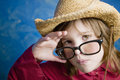 Free Little Girl With Glasses And A Straw Hat Stock Photography - 4518932
