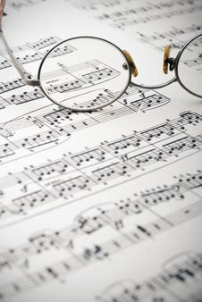 Reading Glasses On Sheet Music Stock Photo