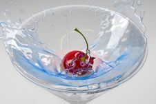 Free Cherry Splashing Into A Cocktail Glass Royalty Free Stock Photo - 4510365