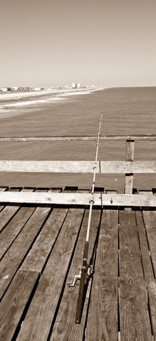 Free Fishing Pole On Pier - Sepia Royalty Free Stock Photos - 4510518