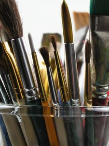 Paint Brushes In Glass Stock Images