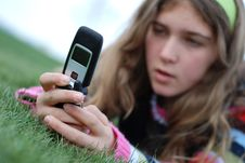 Free Young Girl And Cellphone Royalty Free Stock Photography - 4520137