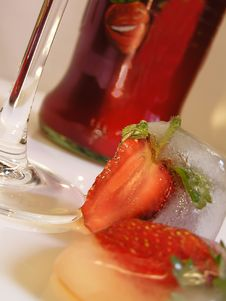 Strawberry In An Ice Stock Images