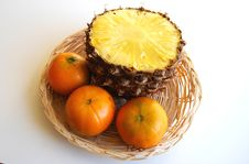They Come From Tropics. Pineapple And Tangerines. Royalty Free Stock Images