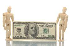 Two Manikins Holding Dollars Bill Stock Image