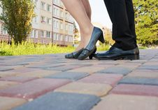 Feet Of Men And Women On A Walk In The Park Stock Image