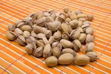 Free A Pile Of Pistachios On Bamboo Table-cloth Royalty Free Stock Photo - 4542545