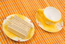 Free Waffle Slice And Empty Cup On Bamboo Table-cloth Stock Images - 4542704
