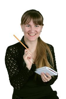 Girl With Pencil And Notebook Stock Photography