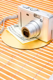 Us Money And Digital Photo Camera Royalty Free Stock Photo