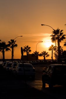 Free Yellow Sunset With Cars And Palms Stock Image - 4544661