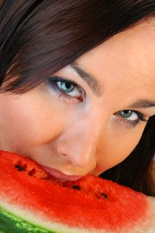 Free Beautiful Brunette Eating A Melon Stock Image - 4544791