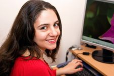 Girl Enjoying The Time On A Computer Royalty Free Stock Images