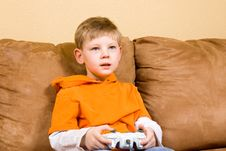 Free Happy Young Boy Playing Video Game Royalty Free Stock Images - 4547039