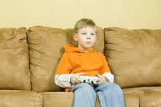 Free Young Boy Playing A Video Game Stock Photos - 4547043