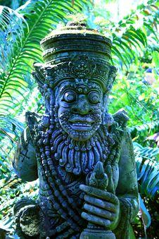 Religious Statue In Tropical Garden Royalty Free Stock Photo