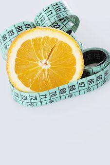 Fresh Orange And Measuring Tape Royalty Free Stock Photos