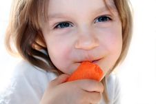 Free Happy Girl Eating Carrot Royalty Free Stock Photos - 4550338