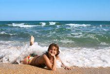 Free Girl In Bikini Sunburning In The Sea Waves Stock Photography - 4551982