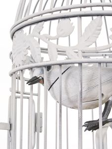 Free Mechanical Bird Looking Of Cage From Side. Stock Photos - 4552933