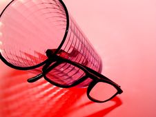Free Pair Of Eyeglasses And Water Glass Royalty Free Stock Image - 4553316