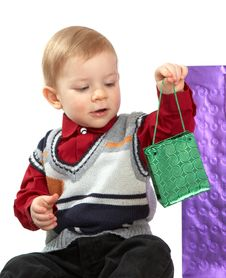 Free Kid Holds A Green Package Royalty Free Stock Image - 4553516