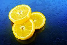 Free Slices Of An Orange On Blue Background Stock Photo - 4554510