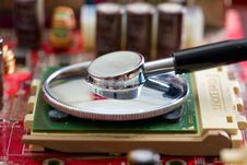 Stethoscope On The Processor Royalty Free Stock Image