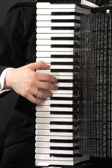 Free The Keyboard Of An Accordion With A Hand Royalty Free Stock Photos - 4557238