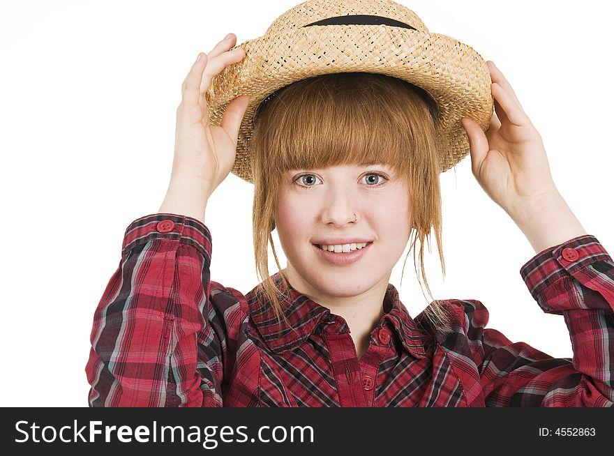 Girl with hand on hat in front