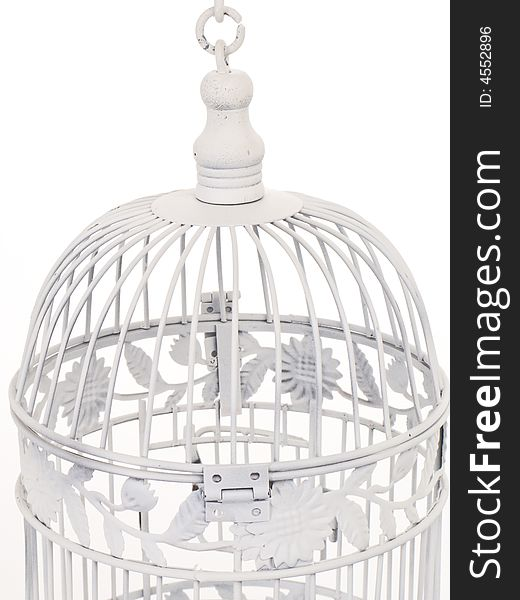 Top of white bird cage.