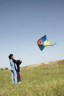 Free Mother And Daughter With Kite Stock Photography - 4560802